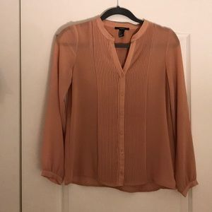 Tan business casual long sleeved top.